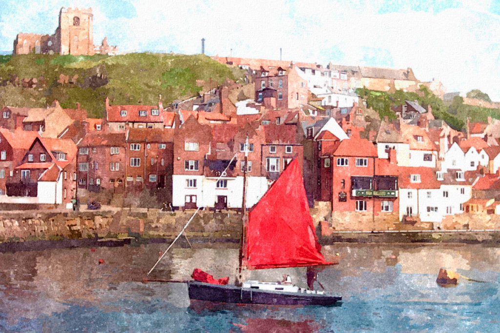 Sailing Boat With Red Sails In Whitby Harbour